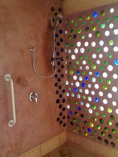 """Instead of throwing those glass bottles away, many folks have wondered how to recycle and build with these ubiquitous items. :: a glass bottled wall!  This photo show walls being constructed on a build in New Mexico by Mike Reynolds at one of his """"earthships""""."""