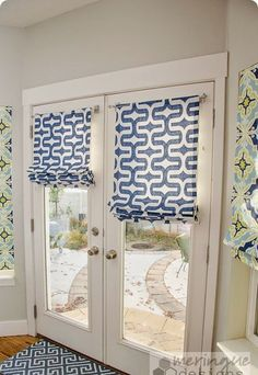 I especially like the sailcloth curtains hung with rivets and and pretty roman shades for french doors i love the easy way these are hung planetlyrics Choice Image