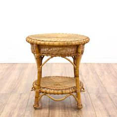 This side table is featured in a durable rattan with a pecan finish. This bohemian style end table has a round woven top and bottom tier, arched stretchers, and wrapped legs. Stylish table that's perfect for the patio! #bohemian #tables #endtable #sandiegovintage #vintagefurniture