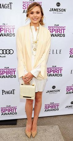 Elizabeth Olsen layered a cream Chloe jacket over a bright white dress from the brand. Nude pumps and a frame bag gave the unstructured pieces a ladylike finish.
