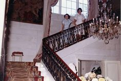 Female staff on the stairs in the Entry Hall at Hillwood