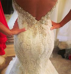 stunning! bridal gown with beading and low v back http://weddings.momsmags.net