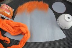 Items required to make the hat and flowers for this wet felting tutorial.