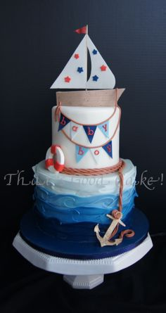 Nautical Baby Shower for a Boy.  All fondant cakes with modeling chocolate boat, sail, bunting, rope, buoy and anchor.