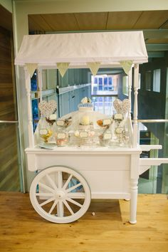 Vintage sweet cart provided by Elegant Wedding Supplies