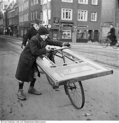 Cas Oorthuys :: Two boys are transporting a door they removed from a demolished building. The Hague, Rotterdam, Life Goes On, Vintage Photographs, World War, Wwii, Netherlands, Holland, The Past