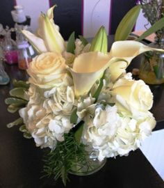 Nothing says elegance like Calla lily's, hydrangea and roses in classic creamy whites.