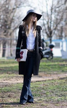 Treat your flared jeans just like any other denim and pair them with a white button-down, knee-length coat and boots—it works every time.