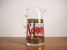 Match ur glasses mom!! Seasons Greetings Cocktail Pitcher Vintage by tatterandfray, $23.00