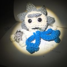 discourtney:: Day 36: Octopus Rick. Complete with flask drool stain and bald spot. I made him with four white tentacles for his lab coat and four blue ones for his shirt. His drool has been needle felted and I used a new method to make his eyes more similar to how they look in the show.