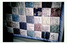 At our wedding, instead of a sign in book, we had our guests sign a piece of cloth that we then turned into a quilt. We have it hanging in our Kitchen as a tapestry, so we can see it every day.