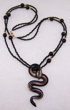 """Cleopatra; Glass Snake Necklace created by Moon Goddess Jewelry.....14K Rose Gold plated beads, clasp & findings, 3"""" glass snake pendant, glass beads and glass seed beads. Approx. 20 1/2"""""""