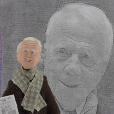 Doll Miniature Robert Frost  Created especially for the lover of classic literature and poetry, my miniature Robert Frost art doll is wearing a dark brown coat with warm bundled scarf and paired with gray cord pants. Roberts face is painted by hand and he has fiber white hair to add a final touch. If you peer real close, you may spy a copy of his poetry too!  This little art character is an original wood creation with the added materials of clay, wire , and paint and he stands a tiny 4 1/2…