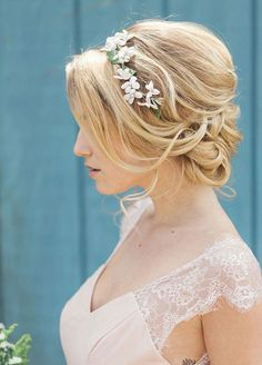 11 Effortlessly Romantic Wedding Hairstyles: Barely pinned bangs and a delicate floral headband look simply stunning.
