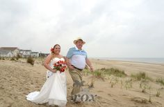 Bride escorted by father to beach wedding during ceremony processional in Fenwick Island DE:  https://www.roxbeachweddings.com/
