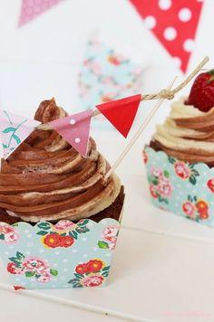 Chocolate Vanilla Swirl Cupcakes made with chocolate cupcakes, then frosted with vanilla and chocolate swirled frosting, And topped with cute mini bunting.