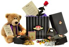 """The holidays will be here before you know it!  Make this a Christmas to remember by sending someone you love a Happy Holidays Hugs Box, exclusively from The Serious Teddy Bear Company! Christmas Hugs is """"bear""""ing special sweet gifts for that special person: Included are 3 boxes of special sweet treats... Hershey Kisses, gourmet jellybeans, and chocolate chip cookies - as well as a heartfelt poem on parchment paper PLUS a special little Happiness book that's sure to warm the heart<3"""