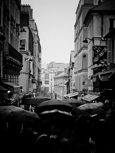 One of my all time favorite pictures > Umbrella Parade, Montmartre - Paris #streettogs #photography