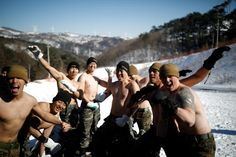 """South Korean and U.S. Marines are conducting military exercises on ski slopes in sub-freezing temperatures, including shirtless hand-to-hand combat in the snow, prompting warnings of retaliation from North Korea over """"madcap mid-winter"""" drills."""