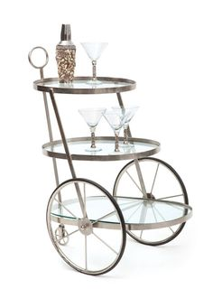 This stylish Bar Cart will make an impression in any room.  Not just for the bar, this unique cart can also be used as an occasional table.
