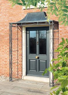 For your front door porch, Garden Requisites offer porch designs in steel. Bespoke metal porches available - Victorian porches and porch canopy designs. Over Door Canopy, Door Canopy Porch, Front Door Porch, Porch Awning, Window Canopy, Patio Canopy, Front Porches, Porch Canopy Designs, Porch Designs