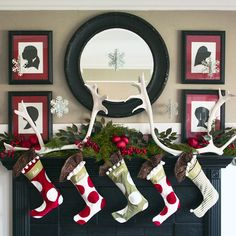 Christmas Mantel with Hanging Snowflakes -- the ONLY time, Bryan, that any part of a deer can be brought into a living room decoration is when reindeers come to your house!  lol