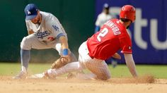 Sliding Dodgers clinch tie for NL west with win over lowly Phillies