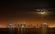 Skyline - San Diego, California at night, by Trodel, via Flickr. ~  Moon occluded by clouds over San Diego, California. Picture by Rufustelestrat. Picture of the Year Finalist 2006 (photo taken 8/2005 using a Nikon D200)