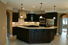 I like the color of backsplash and countertop with the tone of the floor..