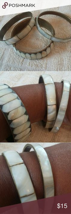 Vintage mother of pearl over brass bangles Three beautiful bangles can be worn together or separately as suggested in photos. Mother of pearl inlays over brass. One wide, one medium, and one thin width. Excellent condition. Not sure of era, maybe 1970s? Price includes ALL THREE! Jewelry Bracelets