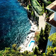 A beautiful view overlooking Hotel Santa Caterina's pool and beach club.