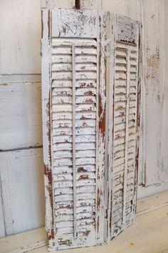 Wooden shutter creamy white distressed