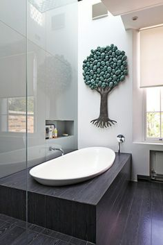 The faces in the tree freak me out, but I love the rest of the bathroom.