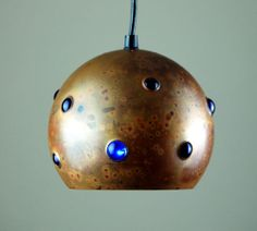 Nanny Still; Patinated Copper and Glass Pendant Light for Raak, 1960s.