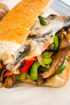 Meaty portobello mushrooms star alongside sauteed onions and peppers topped with provolone cheese then stuffed into toasted garlic bread rolls in this tasty veggie version of a Philly Cheesesteak sandwich. Best Sandwich Recipes, Burger Recipes, Meat Recipes, Seafood Recipes, Whole Food Recipes, Vegetarian Recipes, Best Vegetable Recipes, Mushroom Recipes, Sliced Roast Beef