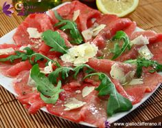 Beef carpaccio with rocket & parmesan is a simple dish and easy to prepare that does not require any cooking and for this you can define a fresh summer dish : it is very thin slices of raw meat, usually beef or veal, which are arranged on a platter, sprinkled with arugula and parmesan cheese and seasoned with olive oil, lemon, salt and pepper. carpaccio was invented by Giuseppe Cipriani , founder of the famous Harry's Bar in Venice that in this wonderful city, in 1950 (Translated from…
