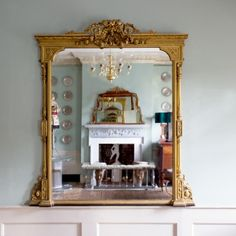 A+mid-Victorian+giltwood+and+composition+overmantel+mirror,