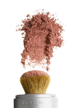 Travel beauty essential: True Match Naturale mineral blush with a built-in brush for color on the go.