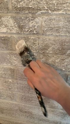 Faux finishing a brick fireplace