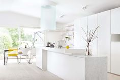 white modern kitchen with pops of yellow