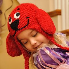 """This adorable dog hat will keep your child's head very warm during the cold winter months. The main portion of the hat uses double-stranded yarn, so divide a skein into two balls. Do not double the yarn while knitting the earflaps or the ears. They will automatically double because of the knitting techniques used. A Turkish Cast-on* was used for the earflaps to prevent the ends from curling out. It also gives the hat a finished look. Hobby Lobby's """"I Love This Yarn"""" (worsted – 100% acrylic)…"""