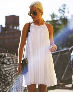 love a short pleated white dress.