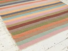 With lovely bright stripes coupled with the herringbone pattern our Tuppence floor rug looks seriously cool and is especially soft under foot.