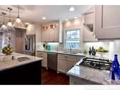 Handsome kitchen nestled between the formal living & dining rooms and open to the new family room.