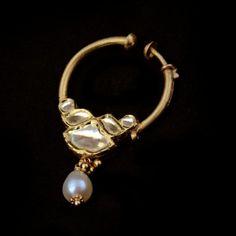 View a range of jadau gold jewellery from Satyanarayan Jadia. Shop for wedding jewellery, precious stone studded jewellery, exquisite diamond jewellery and Nose Ring Jewelry, Indian Jewelry Earrings, Royal Jewelry, Jewelry Shop, Jewelry Design, Nose Rings, Designer Jewelry, Pearl Necklace Designs, Onyx Necklace
