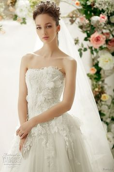 papilio romantic wedding dresses 2012 Her hair is a bit wild but the dress detailing is so pretty.