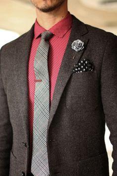 Brown herringbone jacket, burgundy polka dot shirt, grey tartan tie, red tie clip, grey lapel flower, polka skull pocket square