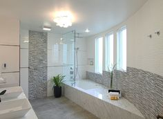 Gray concrete floors were added and white glass tile separated by metal strips were placed on the walls. | found on wayfair.com