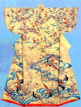 Kosode with design of spring flowers and pheasants Paste-resist (Yuzen) and tie-dyeing on yellow silk crepe (chirimen), The second quarter of the eighteenth century.  the stream running from the top of the mountain to the field spreading at its foot, the azalea arranged at the shoulder, and the dandelion, thistle, field horsetail and other plants depicted in the lower section project an impression of a mountain landscape in late spring.