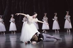 Étoile Isabelle Ciaravola''s Giselle comforts Karl Paquette''s Albrecht at the climax of Act II while the Wilis in the back look on. Photography by Jim Lafferty.